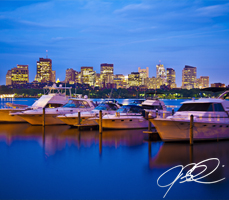 Boston Skyline at Night with Boats on Charles River