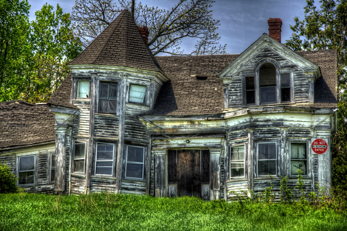 An old Victorian house collapsing along US Route 1 in Searsport, Maine