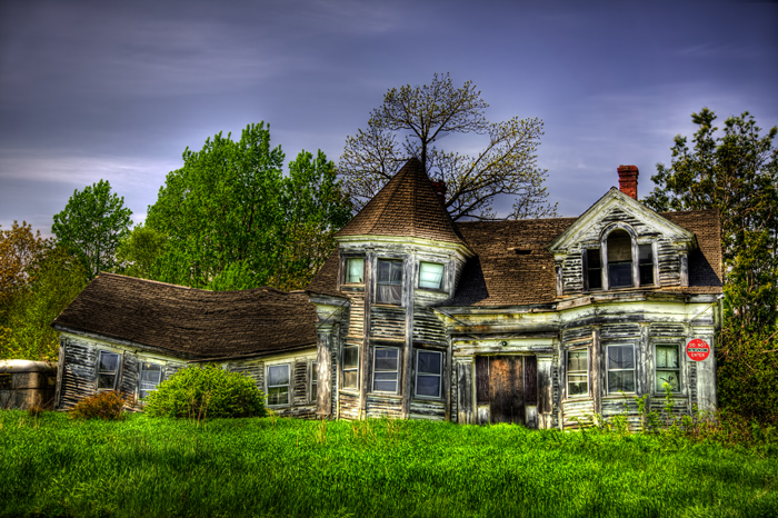 An old, dilapidated Victorian house in Searsport, Maine.