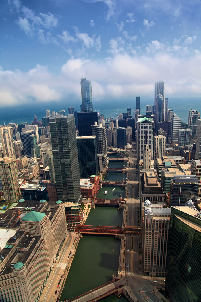 Aerial photograph of downtown Chicago over the Chicago River.
