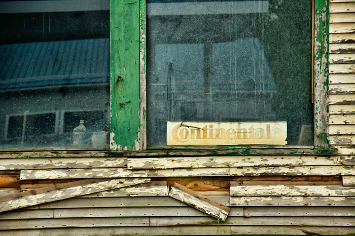 Old Continental Tires sign in a Window in Hardwick, VT