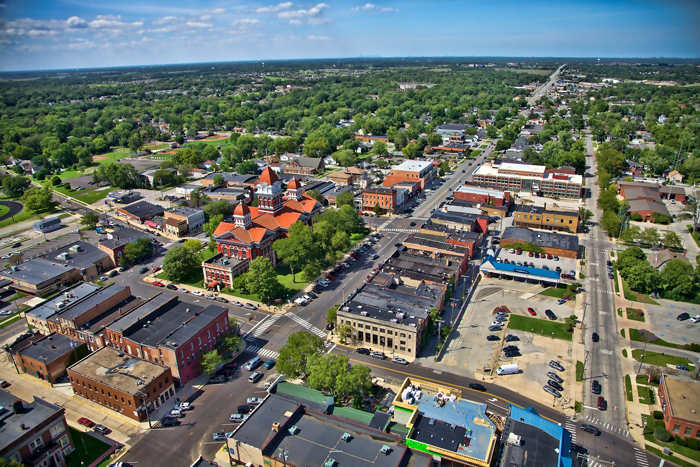 Aerial photo of downtown Crown Point, Indiana featuring the historic Old Lake County Courthouse.