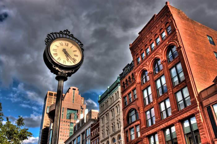 A clock along the street during an evening walk through downtown Louisville, Kentucky.