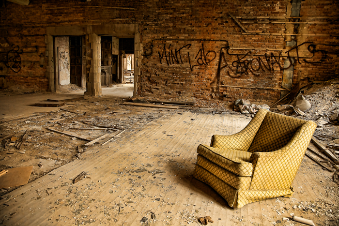 Empty Chair in an Abandoned Building