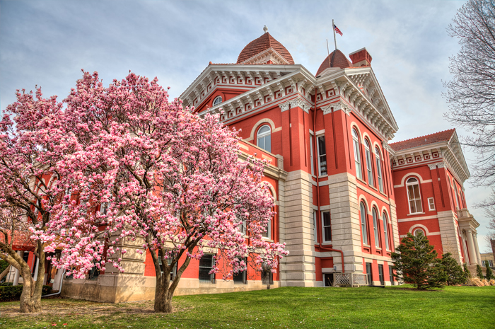 The downtown Crown Point, Indiana square in Northwest Indiana shows its spring colors with flowers and magnolia trees in full bloom.